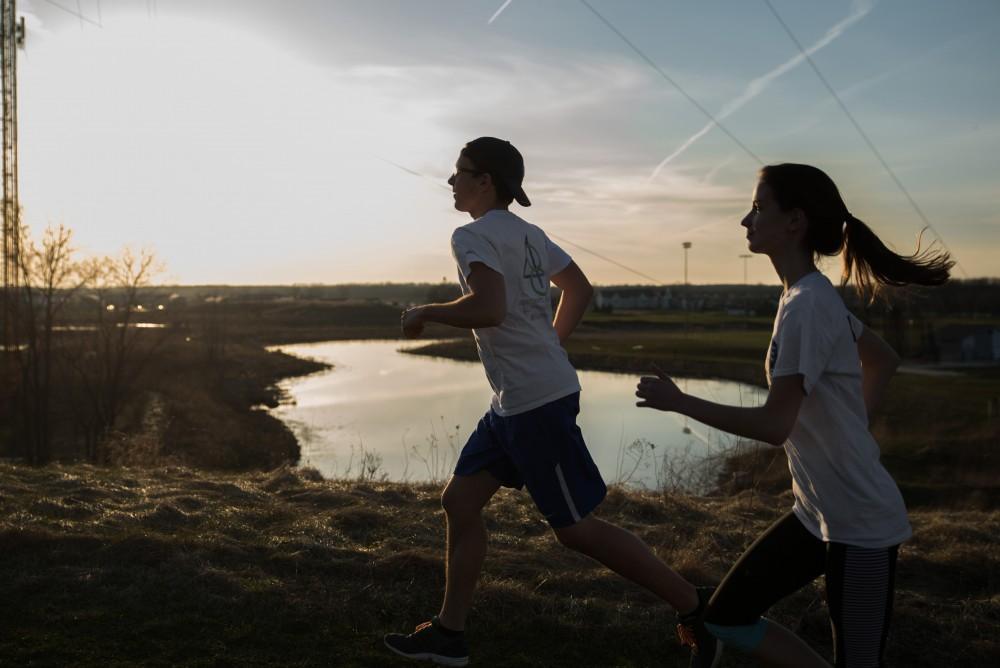 GVL / Luke Holmes - Jacob Salter and Casey Malburg go for a run around Grand Valleys campus.