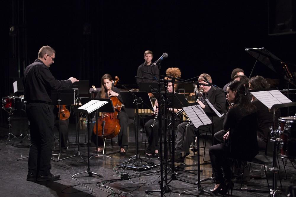 GVL / Sara Carte - Music director Bill Ryan and Grand Valley alumni performs at the GVSU New Music Ensemble 10th Anniversary Concert to begin at the Peter Martin Wege Theatre in Grand Rapids on Saturday, Apr. 2, 2016.
