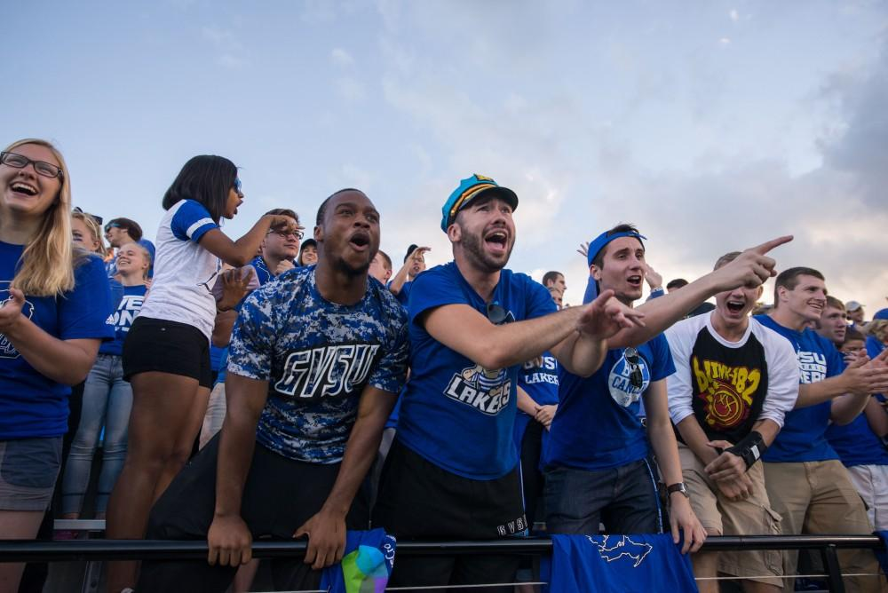 GVL / Luke Holmes - GVSU fans pose for a photo in the student section. GVSU defeated Lake Erie College 55-7 on Saturday, Sep. 10, 2016.