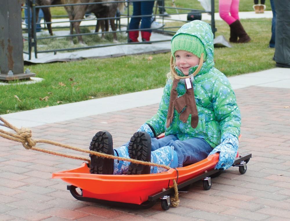 GVL/Archive - Lauren Perni, 4, enjoys a sleigh ride during the first annual GVSU Reindeer games on Friday, Nov. 30, 2012 outside of Grand Valleys Kirkhof Center.
