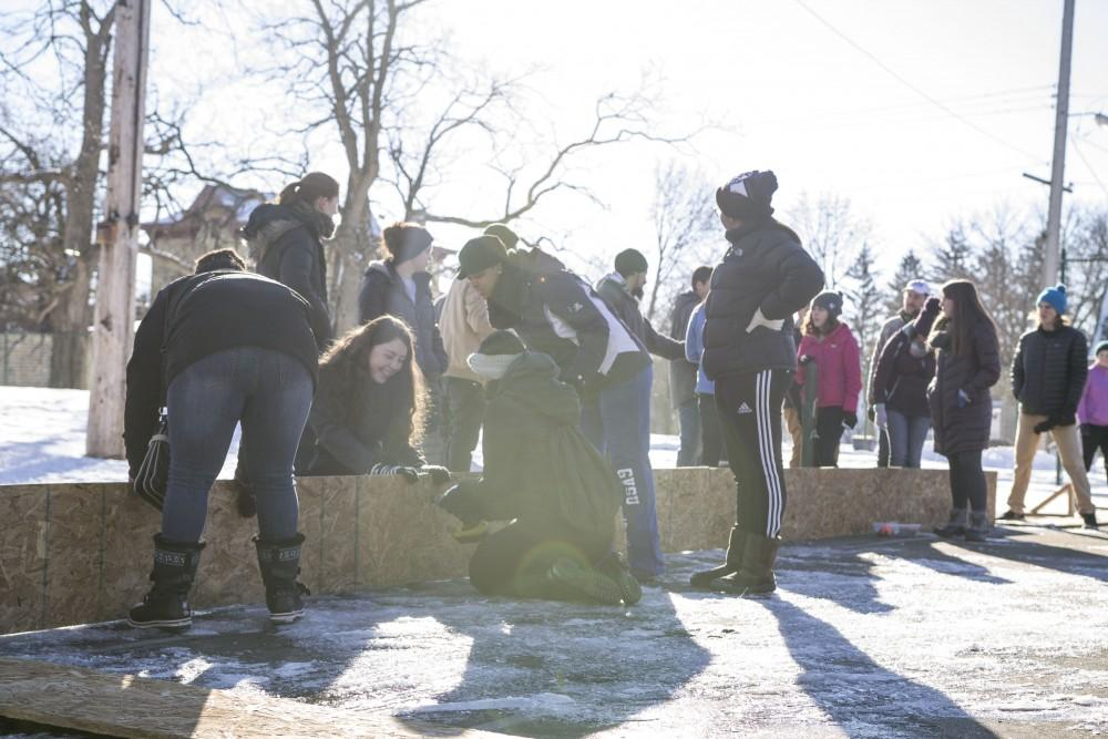 GVL/Sara Carte - Grand Valley students help build Cherry Street Park's new ice rink for the Martin Luther King community service projects on Friday, Jan. 22, 2016.