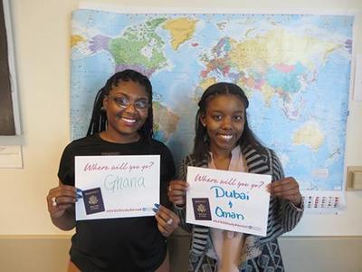GVL / Courtesy - GVSU.eduVanesha Blackburn, left, and Alita Reneau hold signs for their study abroad programs after receiving scholarships to obtain their passports.