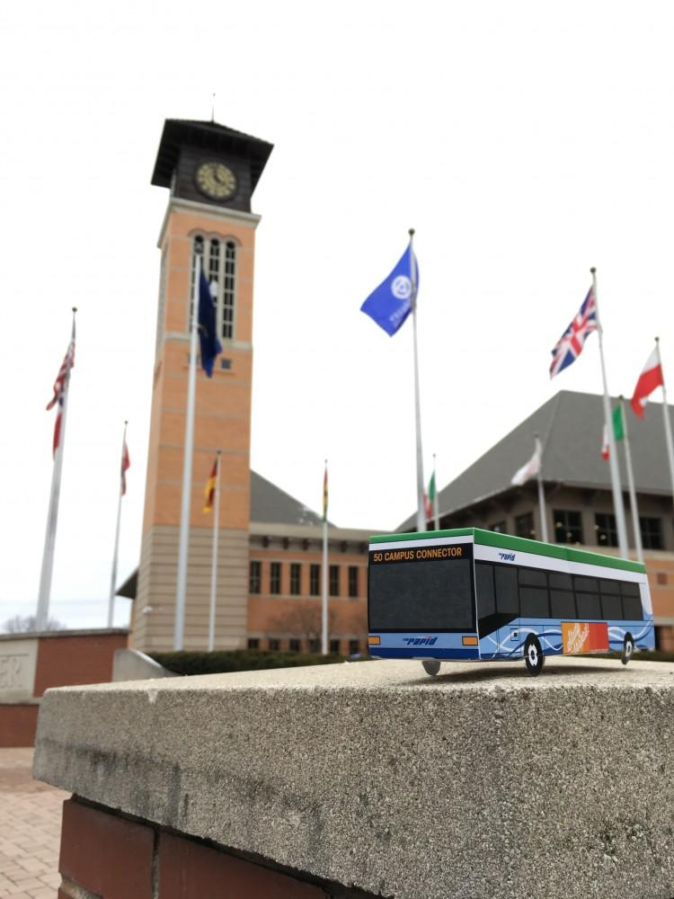 GVL / Courtesy - Alissa Lane Tiny, foldable buses that resemble Grand Valley State University's Route 50 Campus Connector buses are being given out to raise awareness for current study abroad scholarships.