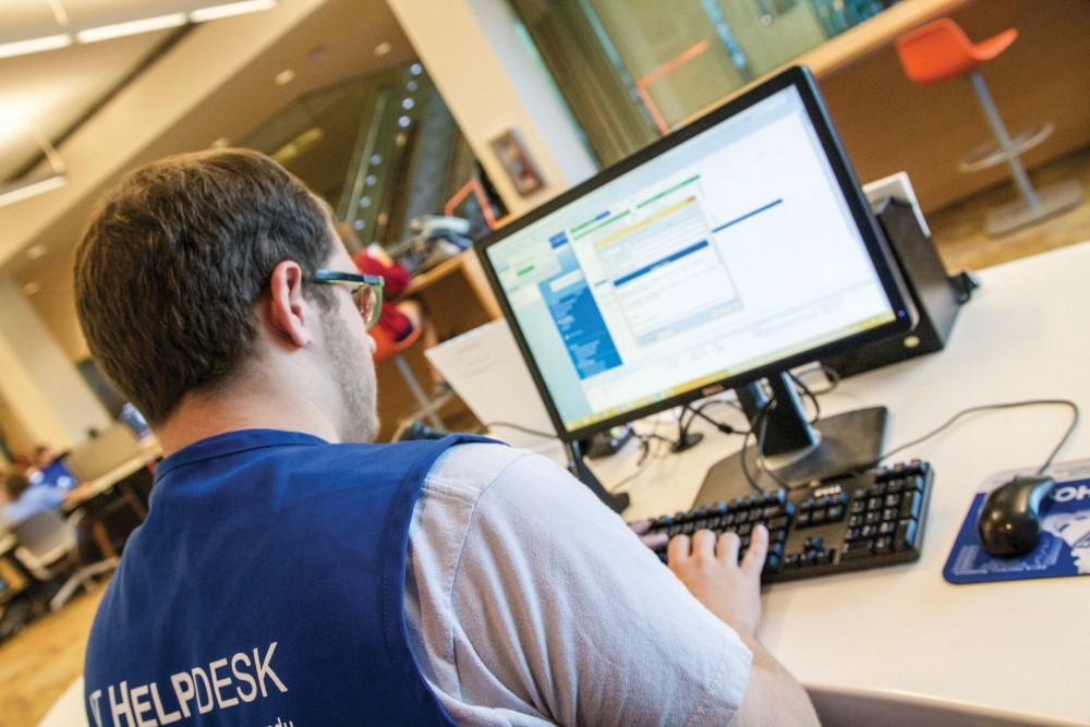GVL / Sara Carte - IT Help Desk worker Grant Miller works on his computer to help students in the Mary Idema Pew Library on Wednesday, Sept. 23, 2015.