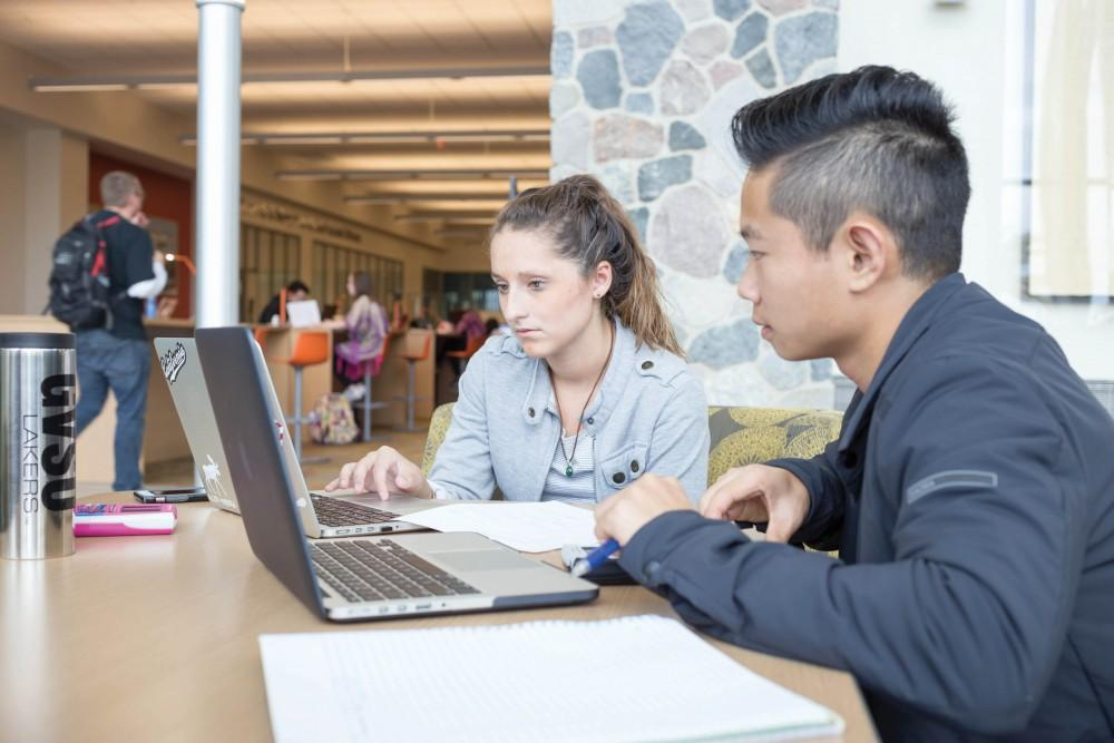 GVL / Sara CarteCallie Spytman (left) and Lee Hewson (right) study for their exams in the Mary Idema Pew Library on Tuesday, Oct. 11, 2016.