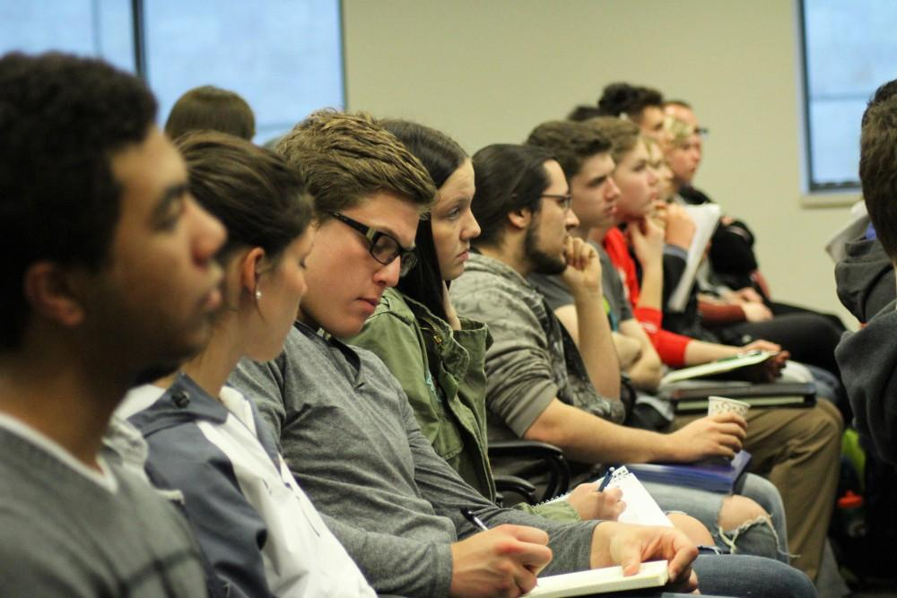 GVL / Kasey Garvelink - Students took notes while attending the Student Scholars Day keynote Lecture presented by Dr. David Wineland on Wednesday, Apr. 13, 2016 in Allendale.