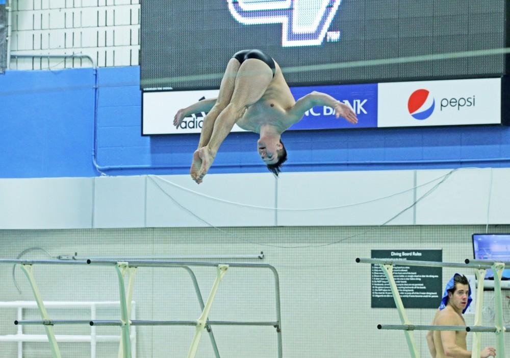 GVL/Emily Frye - Brad Dalrymple dives on Saturday Jan. 28, 2017.