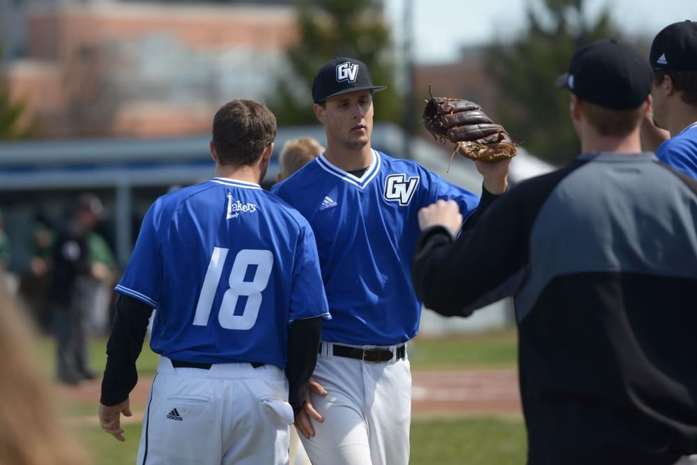 GVL/Kevin Sielaff - Connor Glick (16) prepares to make a catch during the game vs. Ashland on Wednesday, April 12, 2017.