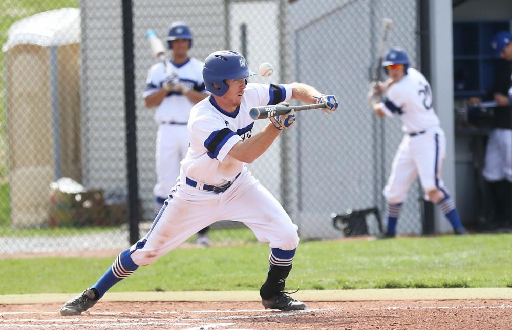 GVL/Kevin Sielaff - Alex Young (12) tries a bunt during the game vs. Ashland on Wednesday, April 12, 2017.