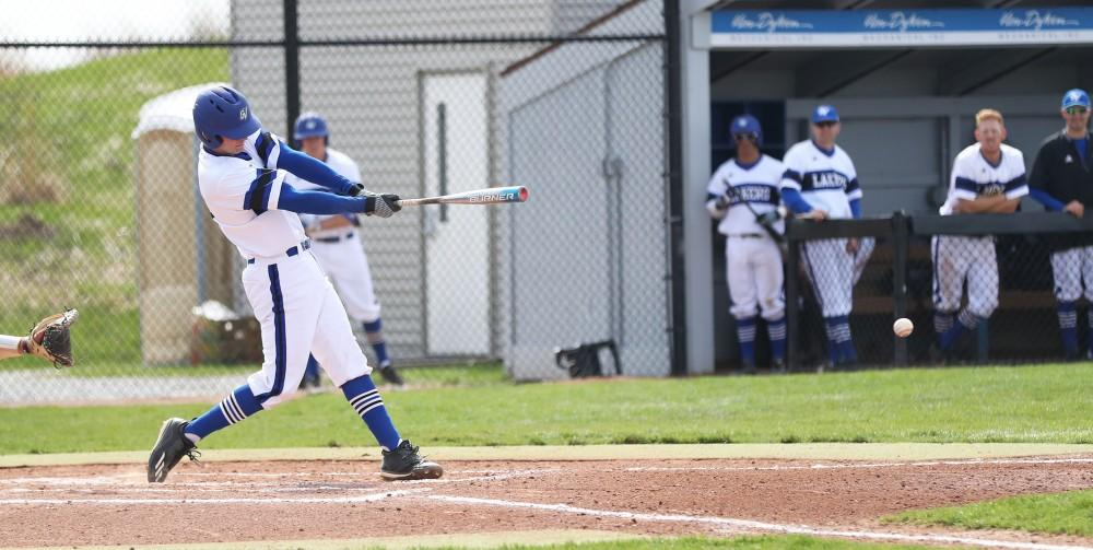GVL/Kevin Sielaff - Connor Glick (16) makes contact with the ball during the game vs. Ashland on Wednesday, April 12, 2017.