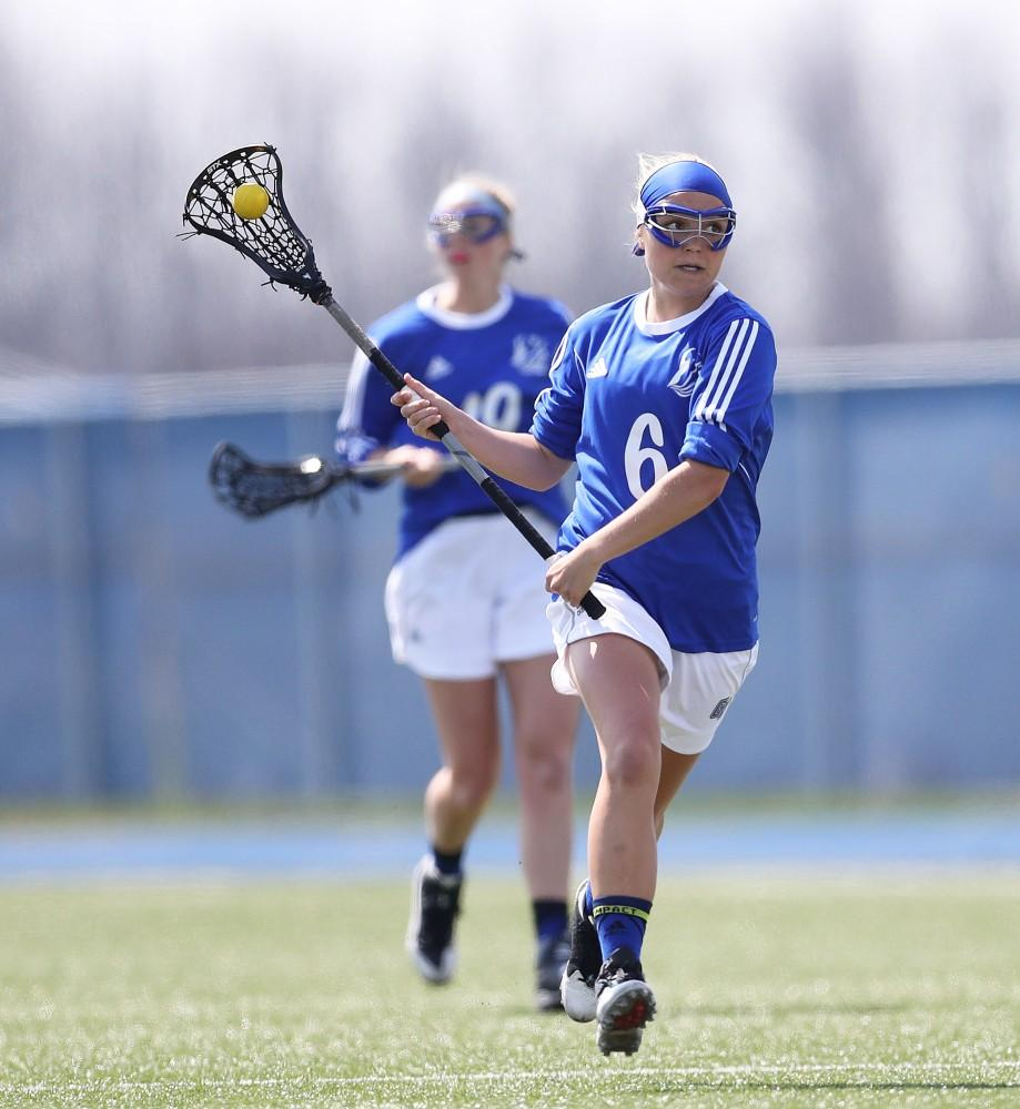 GVL/Kevin Sielaff - Ashley Bailey (6) moves the ball up the field during the game vs Northern Michigan on Saturday, April 15, 2017.