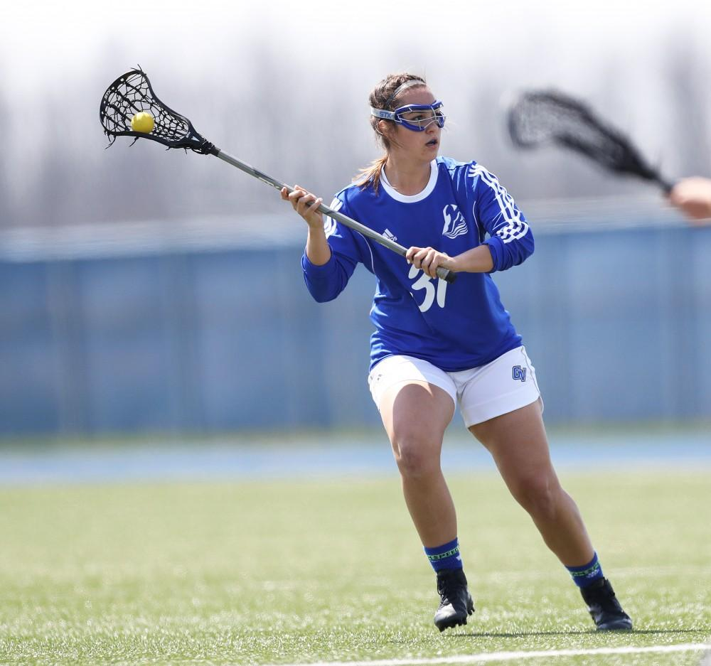 GVL/Kevin Sielaff - Carolina Reis (31) holds the ball in Northerns zone during the game vs Northern Michigan on Saturday, April 15, 2017.