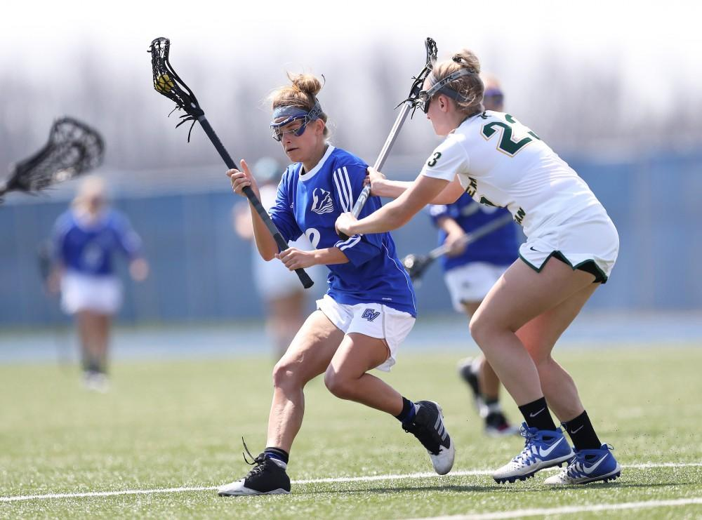 GVL/Kevin Sielaff - Maria DAngelo (13) spins in front of Northerns net and tries a shot during the game vs Northern Michigan on Saturday, April 15, 2017.