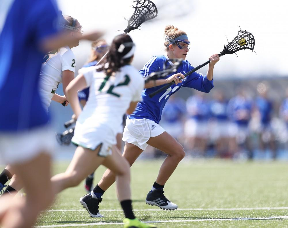 GVL/Kevin Sielaff - Maria DAngelo (13) moves in on Northerns net during the game vs Northern Michigan on Saturday, April 15, 2017.