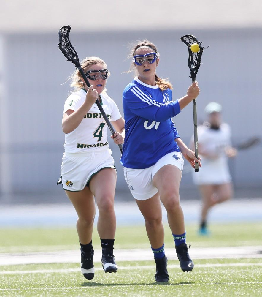 GVL/Kevin Sielaff - Carolina Reis (31) controls the ball and carries it up field during the game vs Northern Michigan on Saturday, April 15, 2017.
