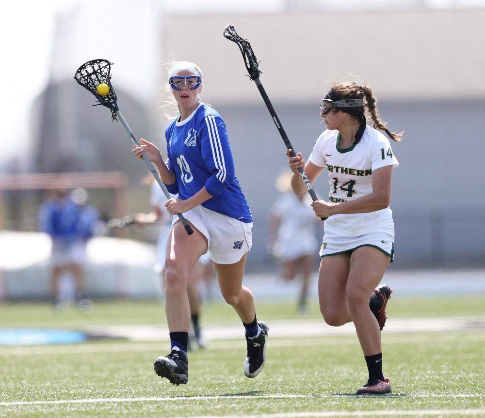 GVL/Kevin Sielaff - Aimee Hite (19) protects the ball as she moves up field during the game vs Northern Michigan on Saturday, April 15, 2017.