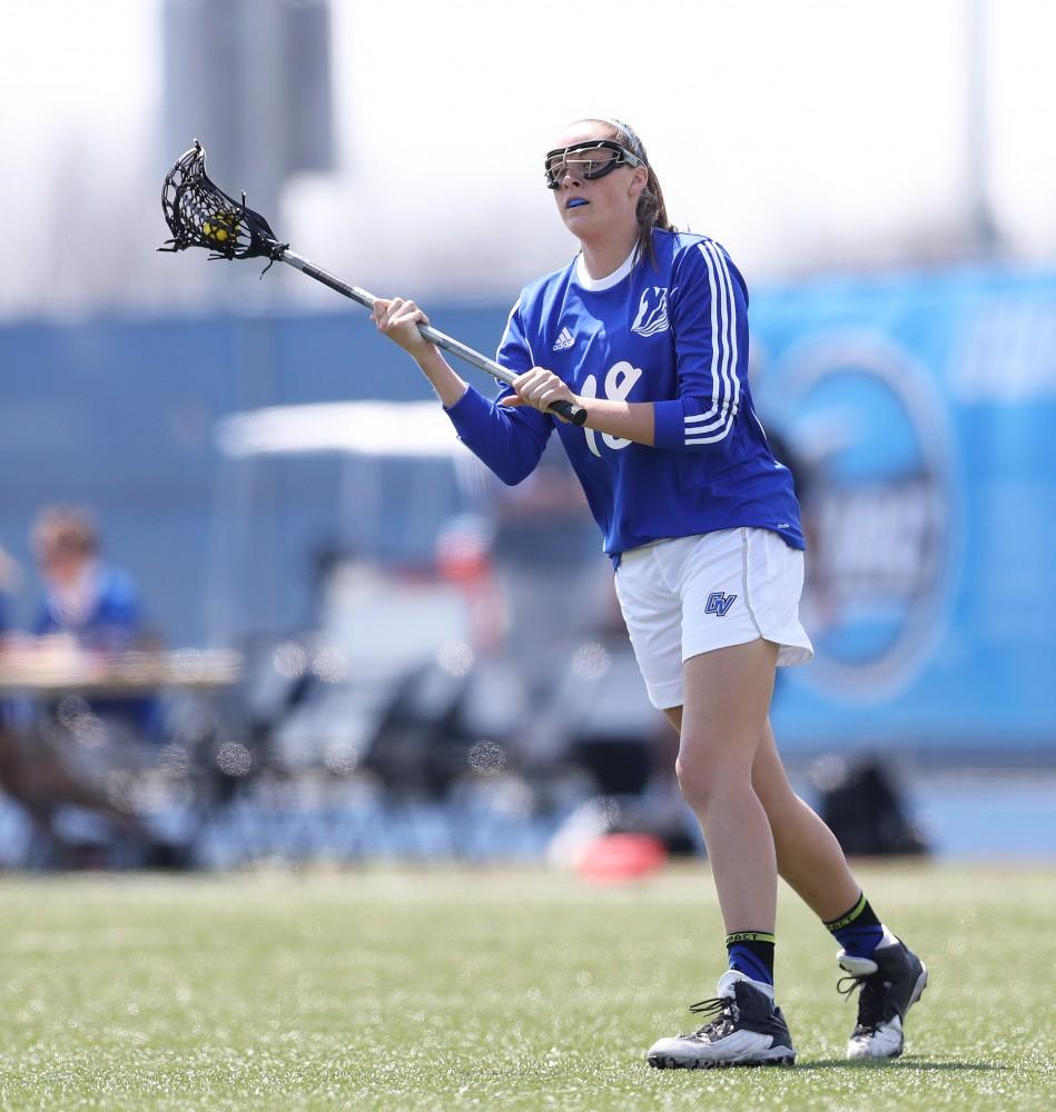 GVL/Kevin Sielaff - Meghan Datema (18) controls the ball and sets up a play during the game vs Northern Michigan on Saturday, April 15, 2017.