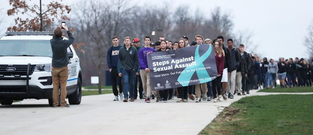GVL/Kevin Sielaff - Grand Valleys Interfraternity Council holds a silent march around campus against sexual assault on Tuesday, April 11, 2017.