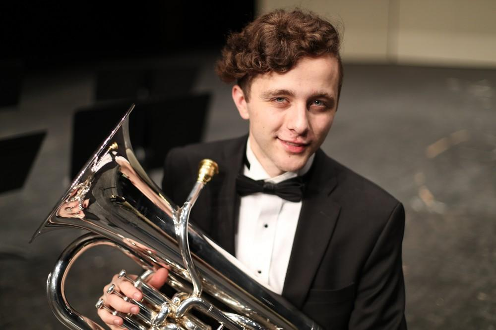GVL/Kevin Sielaff - Nikolaus Schroeder poses for a photo on the stage of the Louis Armstrong Auditorium on Friday, April 14, 2017.