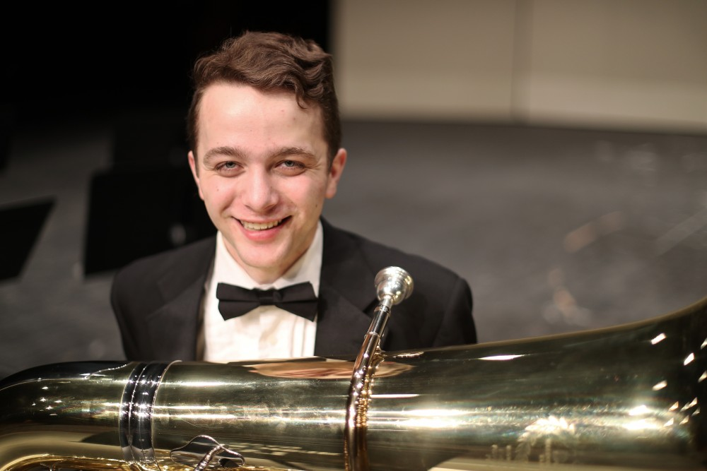 GVL/Kevin Sielaff - Lukas Schroeder poses for a photo on the stage of the Louis Armstrong Auditorium on Friday, April 14, 2017.