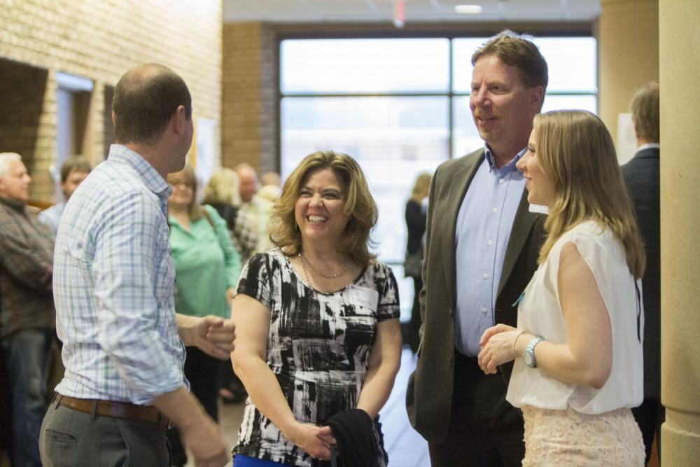 GVL/Mackenzie Bush - Family, friends, professors, and faculty come together to celebrate GVSU students. The Student Awards Convocation Ceremony was held in the Eberhard Center Monday, April 10, 2017.