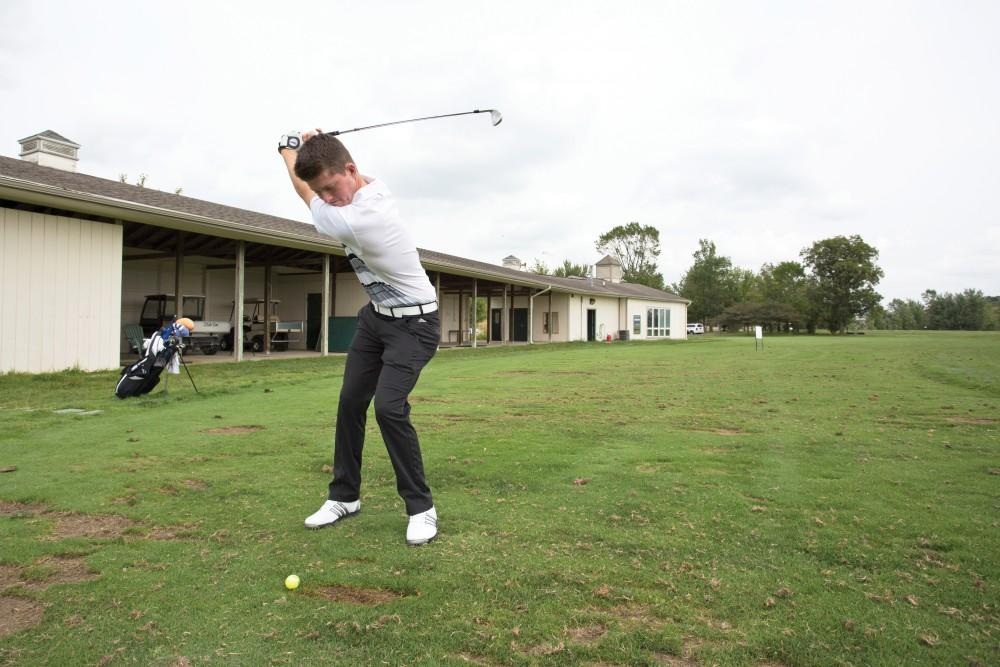 GVL / Kevin SielaffFreshman Bryce Messner leans back to take a swing Friday, August 28th, 2015.