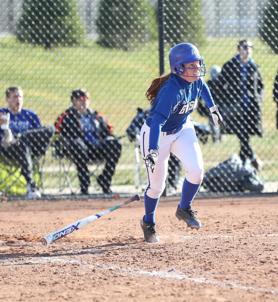 GVL/Kevin Sielaff - Jenna Lenza (4) drops her bat after hitting in a couple runs during the game vs. Lewis on Tuesday, March 28, 2017.