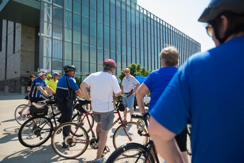 GVL / Luke Holmes - Students and faculty gather outside the Mary Idema Pew Library on their bikes.
