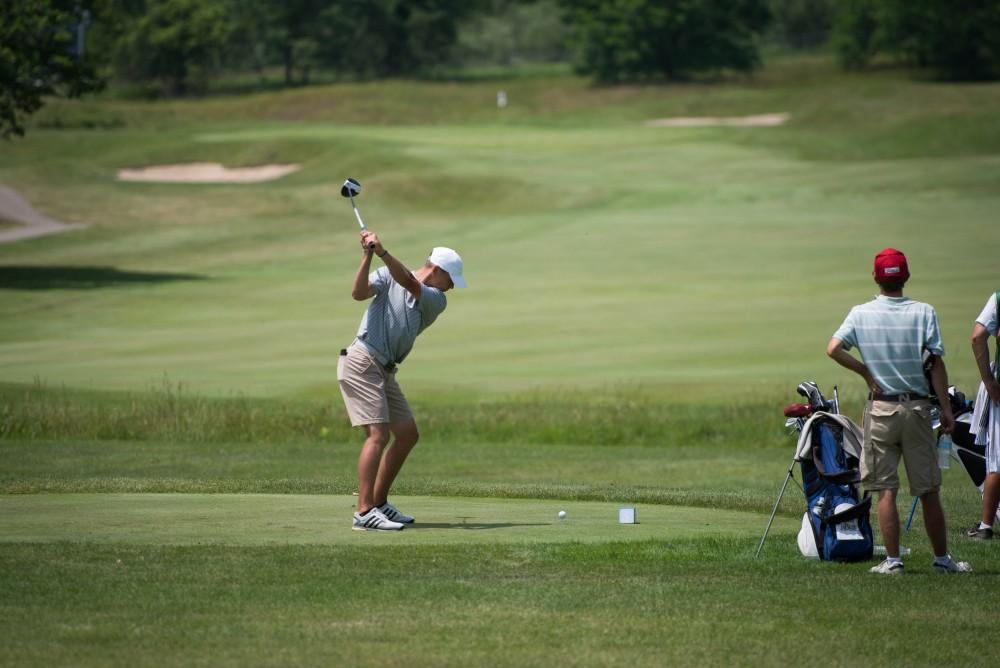 GVL / Luke Holmes - Grand Valley senior, Andrew Stevens, tees off. The first round of match play for the Michigan Amateur was held at Egypt Valley Country Club on Thursday, June 22, 2017.