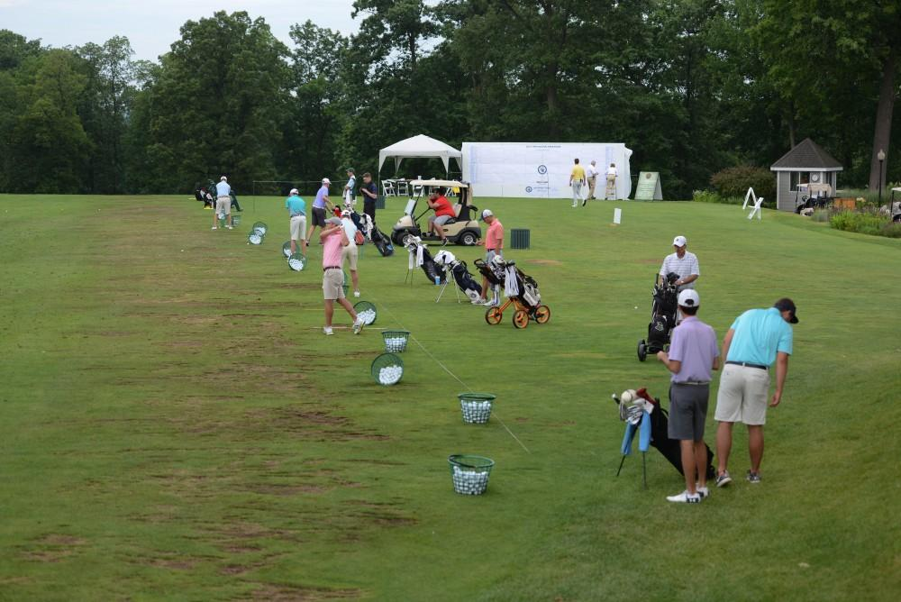 GVL / Luke Holmes - Players warm up on the range. The first round of match play for the Michigan Amateur was held at Egypt Valley Country Club on Thursday, June 22, 2017.