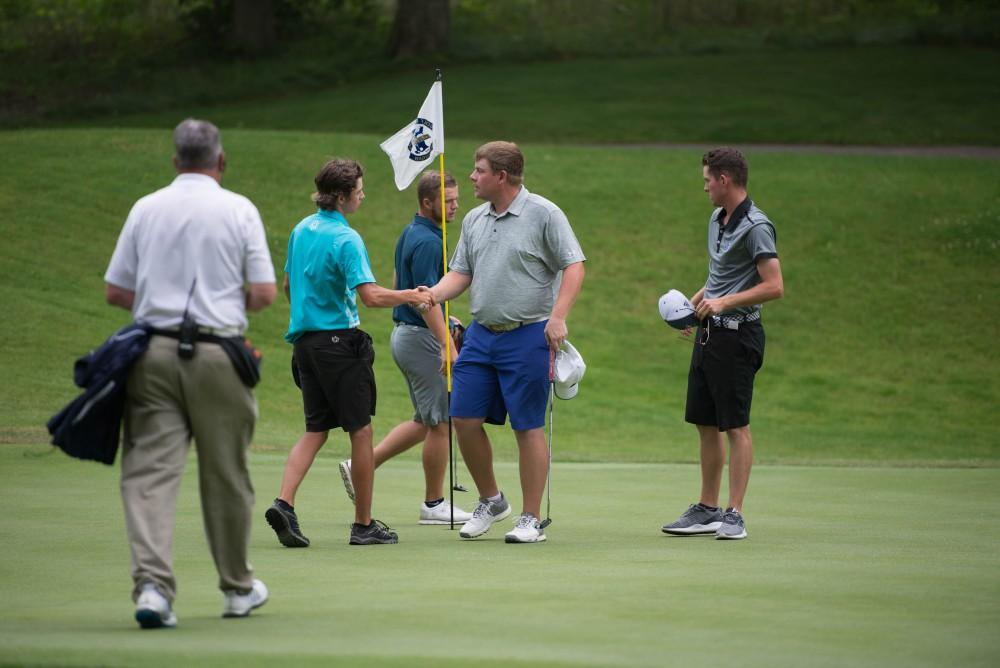 GVL / Luke Holmes - Players shake hands after their match. The first round of match play for the Michigan Amateur was held at Egypt Valley Country Club on Thursday, June 22, 2017.