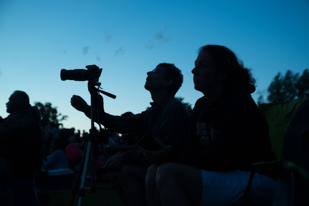 GVL / Luke Holmes - A man positions his tripod to photograph the balloons. The Michigan Challenge Balloonfest was held in Howell, MI on Saturday, June 24, 2017.