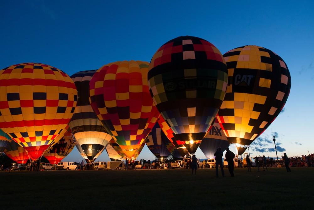 GVL / Luke Holmes - The sun sets behind the balloons. The Michigan Challenge Balloonfest was held in Howell, MI on Saturday, June 24, 2017.