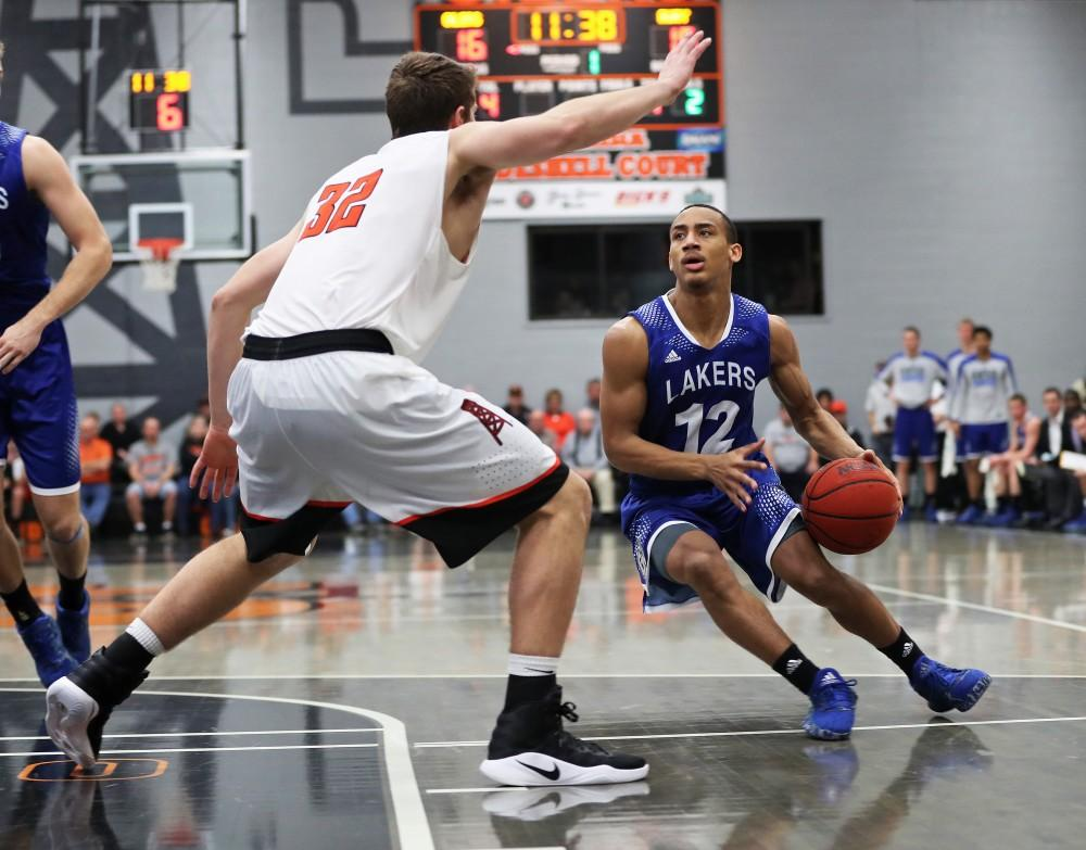 GVL/Kevin Sielaff - Myles Miller (12) moves in to the paint during the game versus Findlay at the University of Findlay on Tuesday, Feb. 28, 2017.