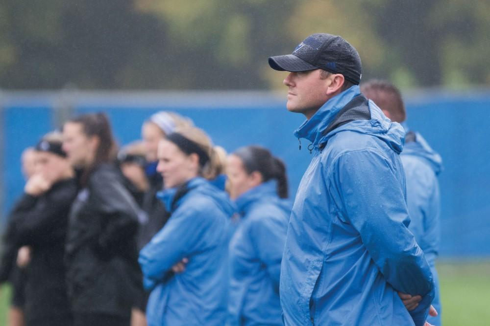 GVL / Luke Holmes - Head Coach, Jeff Hosler, looks on to the play. GVSU Women's Soccer defeats University of Findlay at home Sunday, Oct. 16, 2016.