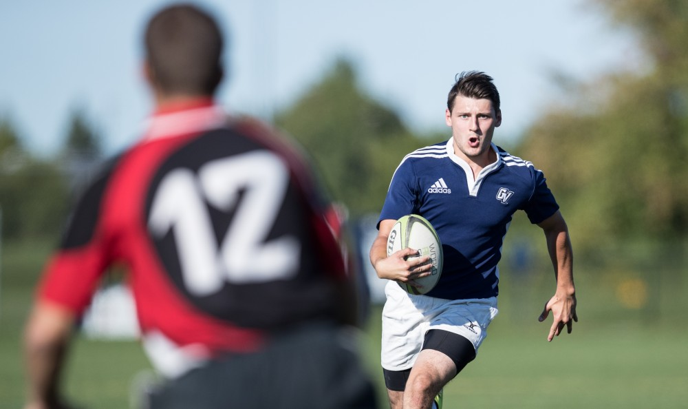 GVL/Kevin Sielaff - Andrew Novak (10) moves the ball up field and scores. GVSU mens club rugby defeats rival SVSU by a large margin Saturday, Sept. 24, 2016.