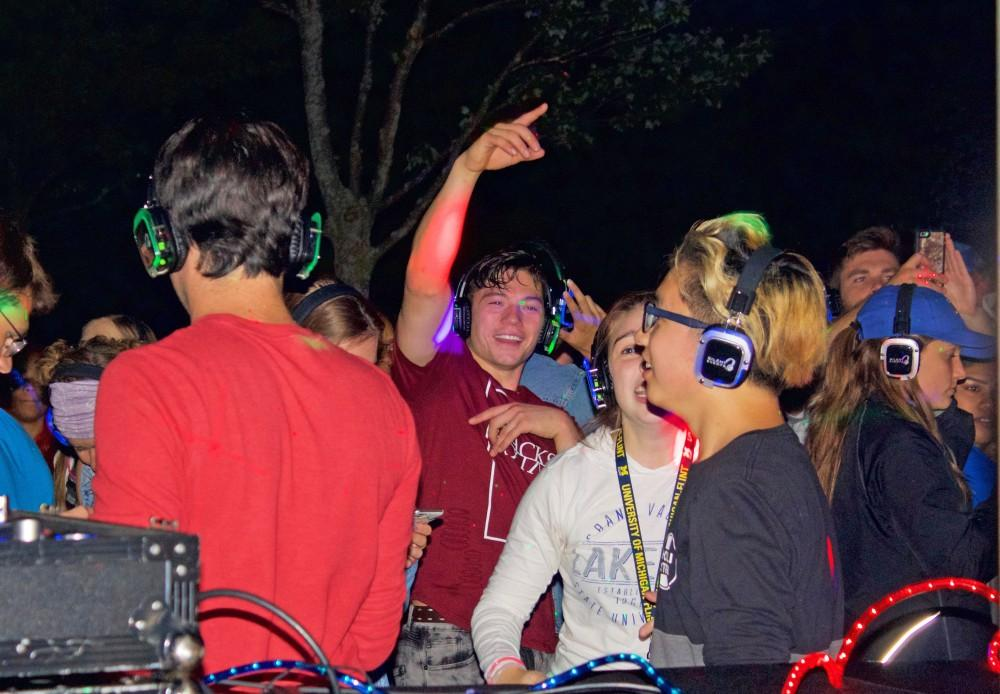 GVL / Hannah Hill   Students dancing and getting the night started at the silent disco on Friday, September, 9th. The dance was open to all students and provided an opportunity to stay involved in the Grand Valley Community