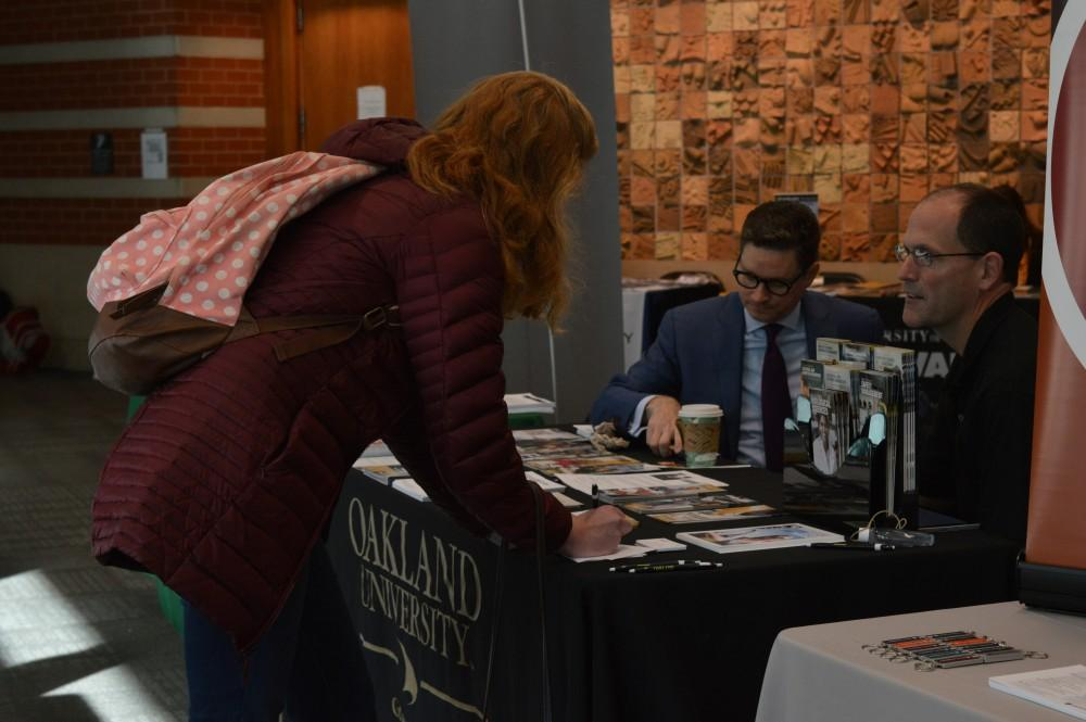 GVL/Hannah Zajac-- Hannah Todd, Junior and Psycology major, talks to Oakland University about graduate school options in Henry Hall on Wednesday 25 Oct 2017.