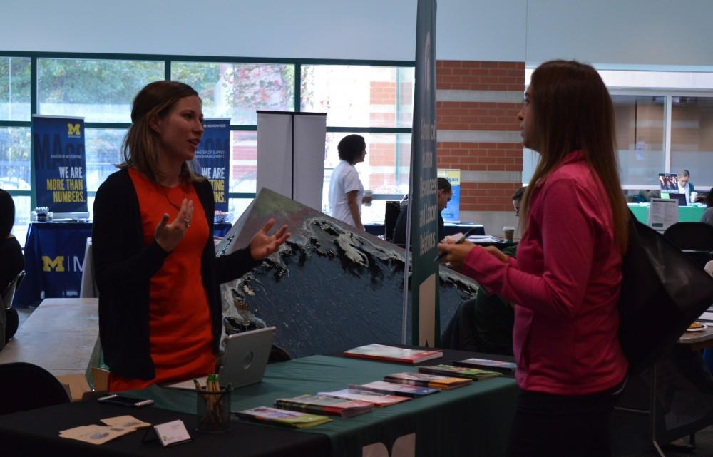 GVL/Hannah Zajac-- Phylicia Zarnosky, Senior and BMS major, talks to multiple tables about her future graduate school options in Henry Hall on Wednesday 25 Oct 2017.