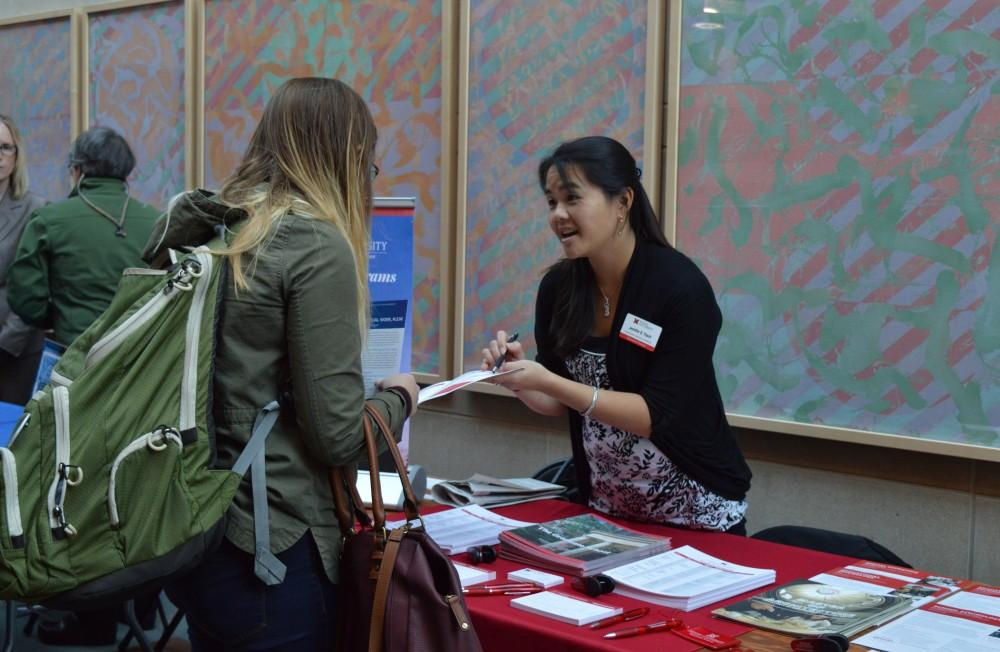 GVL/Hannah Zajac-- Dorie Sullivan, Junior and Psycology major, talks to multiple schools about grad school requirements in Henry Hall on Wednesday 25 Oct 2017.