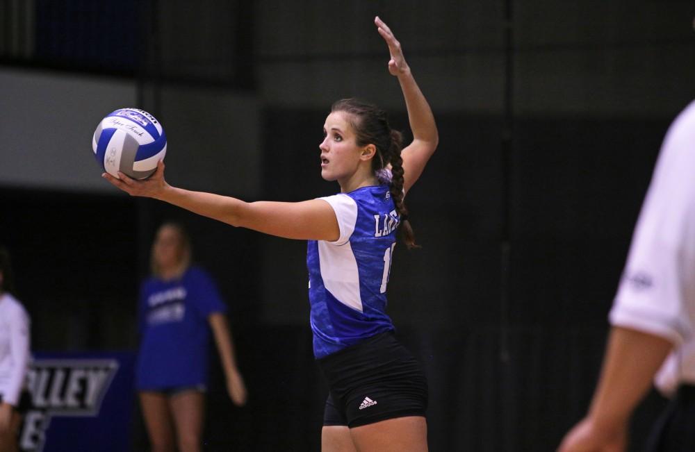 GVL / Emily Frye Sydney Doby serves the ball during the game against Wayne State University on Sept. 20, 2017.