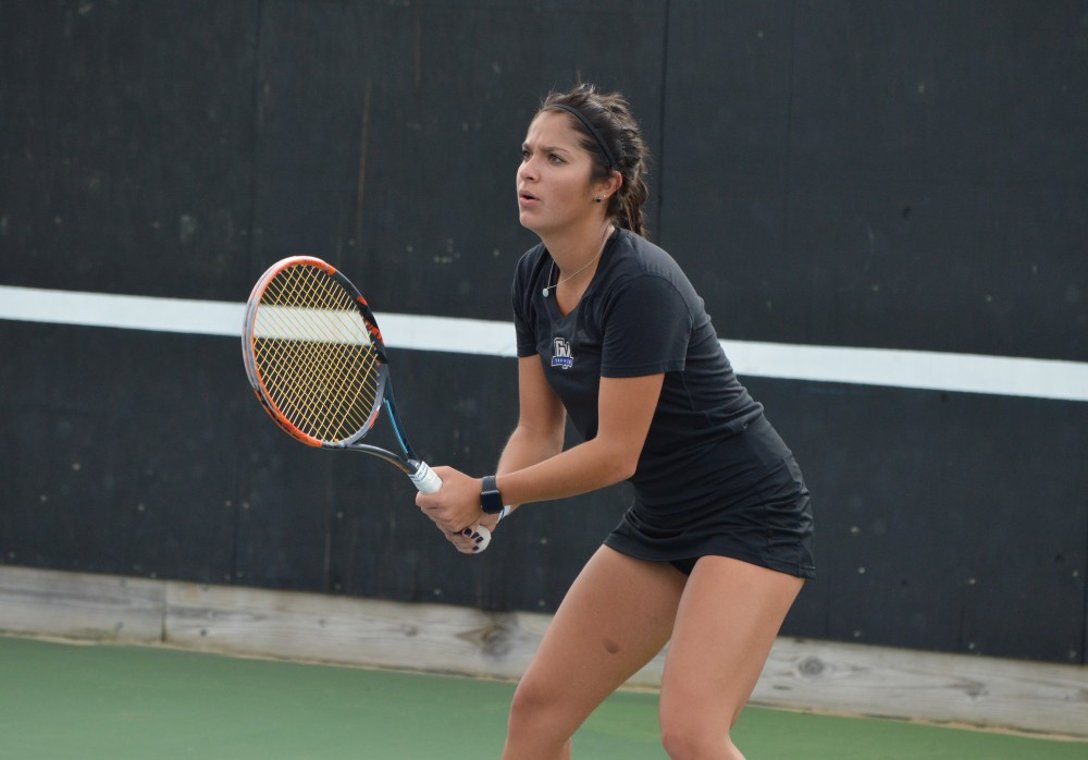 GVL/Hannah Zajac-- Alexa Sweeney plays a strong doubles match against Saginaw Valley on Satuday 21 Oct 2017.