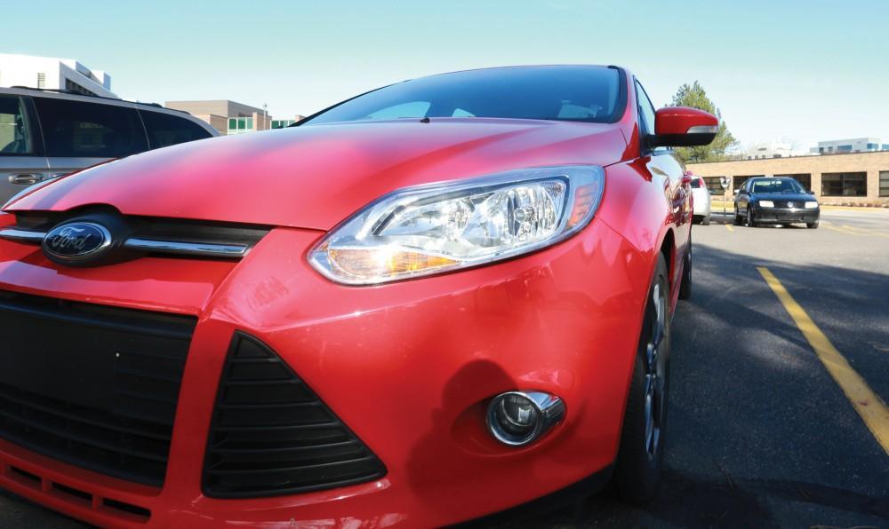 GVL / Kevin Sielaff  Grand Valleys car share vehicle sits in the Kirkhof parking lot on Nov. 29, 2015.
