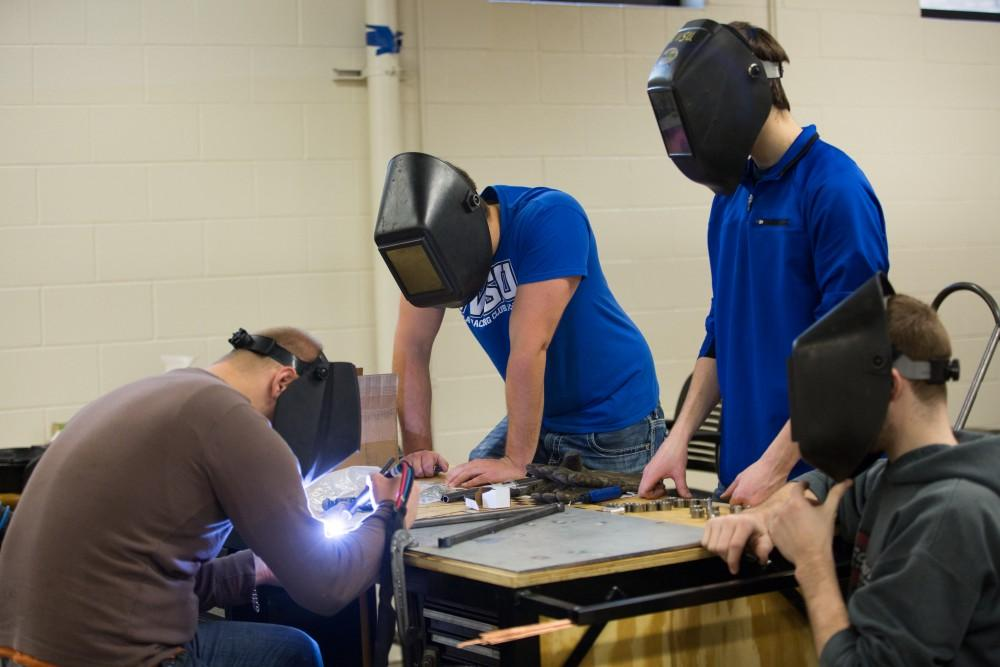 GVL / Kevin Sielaff - A-arms are assembled by members of the GVSU Formula SAE racing team Saturday, Feb. 27, 2016 inside the vehicle bay at Grand Valley's John C. Kennedy Hall of Engineering.