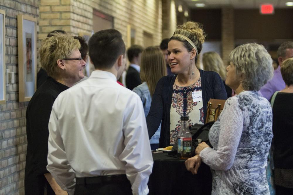 GVL/Mackenzie Bush - GVSU Student talks with family and friends. The Student Awards Convocation Ceremony was held in the Eberhard Center Monday, April 10, 2017.