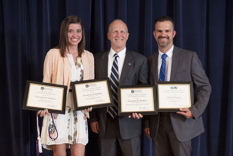 """GVL / Courtesy - gvsu.edu    Samantha Mackay (left) was awarded the """"Outstanding Masters Thesis Award,"""" Award for Excellence in Service to Community/Profession,"""" and the """"Award for Best 3 Minute Thesis Presentation for her accomplishments in 2016-17."""