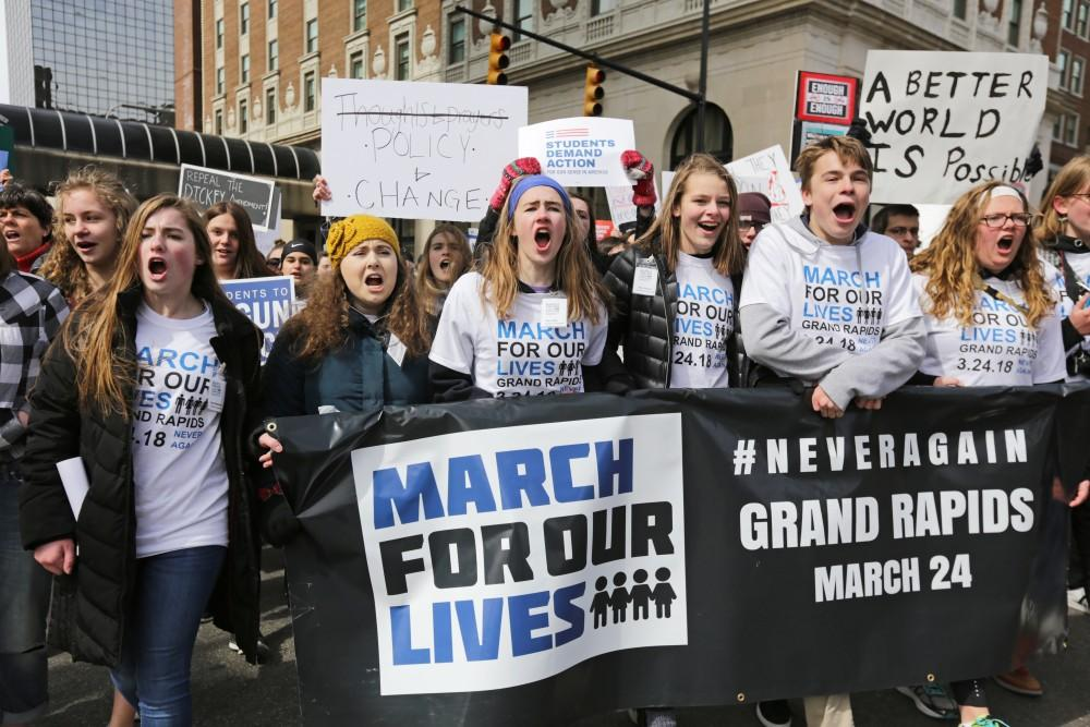 <p>GVL / Emily Frye</p> <p>Student leaders from Forest Hills Northern High School direct the 'March for Our Lives' protest in Grand Rapids, Michigan, on Saturday, March 24.</p>