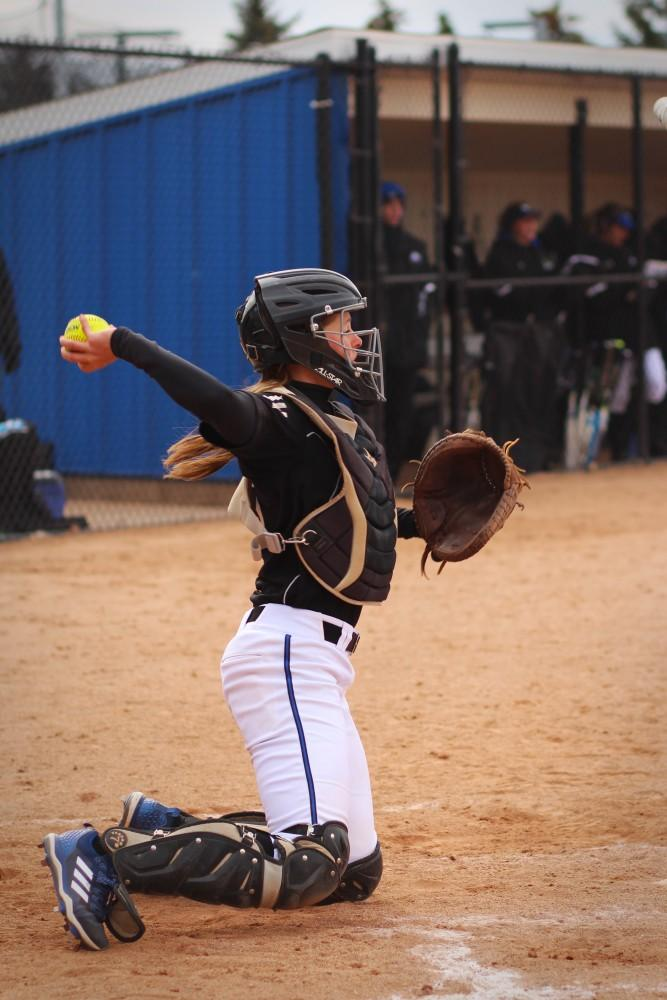 GVL / Sheila BabbittGVSU's catcher catches a strike at the home game vs Northwood Univeristy on March 24th, 2018.