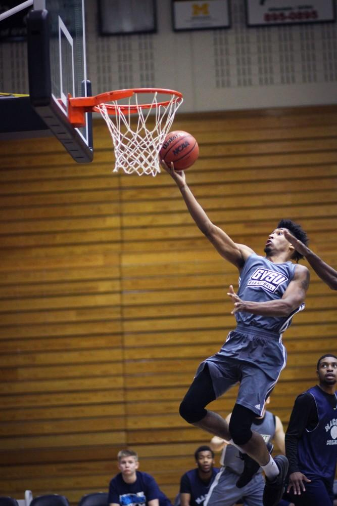 <p>Justin Greason goes in for a layup during the scrimmage against Macomb on Sunday October 22, 2017. GVL/ Sheila Babbitt</p>