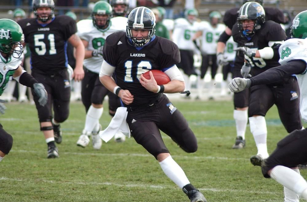 <p>Former Laker Quarterback Cullen Finnerty runs the ball against North Dakota during his senior season.   GVL / Archive</p>